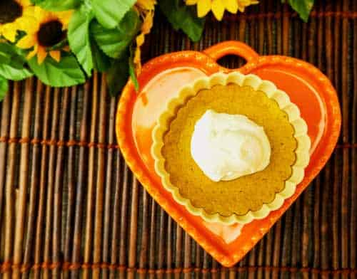 Crustless Pumpkin Pie Recipe to die for. All the goodness of pumpkin pie without the carbs and grains. 4 Net Carbs. Gluten Free | Keto Friendly | Single Serving Portion Control. #Keto #Thanksgiving #CrustlessPie #PumpkinPie #KetoThanksgiving