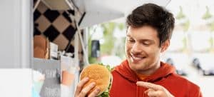 Image of Man With Hamburger